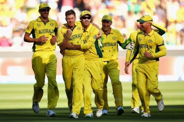 James Faulkner of Australia celebrates with his team mates after dismissing Black Caps allrounder Corey Anderson.