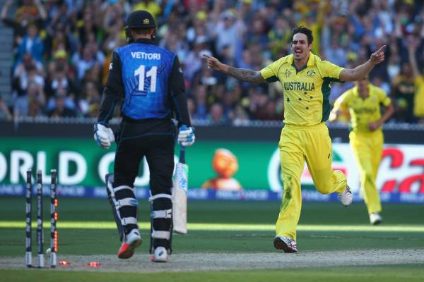 Australian fast bowler Mitchell Johnson celebrates taking the wicket of Daniel Vettori in the Cricket World Cup final.