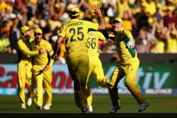 Mitchell Johnson and Brad Haddin celebrate after the dismissal of Luke Ronchi in the Cricket World Cup final.