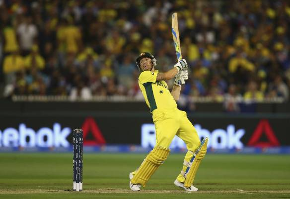 Aussie skipper Michael Clarke sends one to the boundary against the Black Caps in the Cricket World Cup final at the MCG.