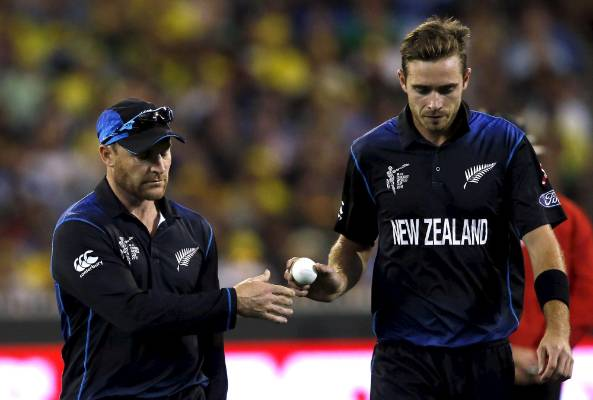 New Zealand's captain Brendon McCullum (left) hands the ball to bowler Tim Southee in the Cricket World Cup final at ...