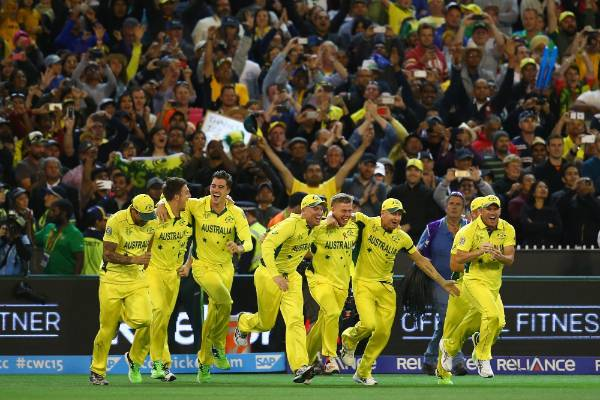 Members of the Australian cricket team take to the field in celebration after beating the Black Caps to win the Cricket ...