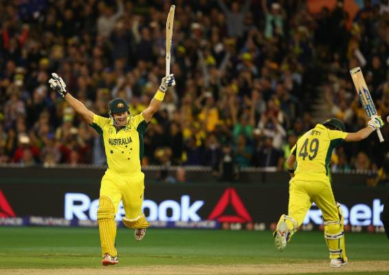 Shane Watson and Steve Smith of Australia celebrate after beating the Black Caps to win the Cricket World Cup in Melbourne.