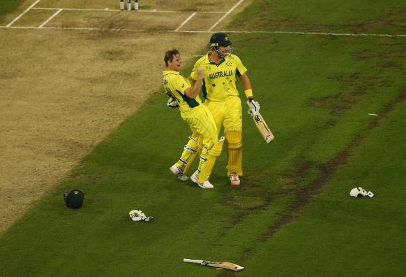 Aussie batsmen Shane Watson and Steve Smith celebrate after beating the Black Caps to win the Cricket World Cup in Melbourne.