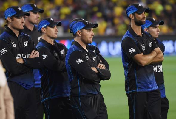 Brendon McCullum and the Black Caps look on after losing the Cricket World Cup final by seven wickets to Australia at ...