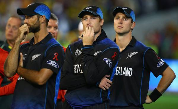 Grant Elliott, Martin Guptill and Matt Henry of New Zealand look dejected after their seven-wicket loss to the ...