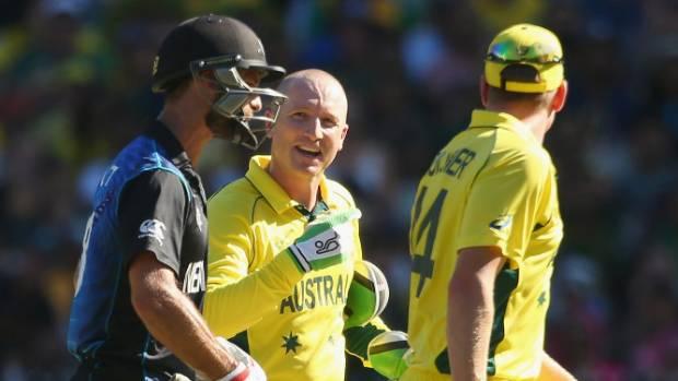 Brad Haddin, centre, shows his usual lack of class as he goads fallen NZ batsman Grant Elliott.