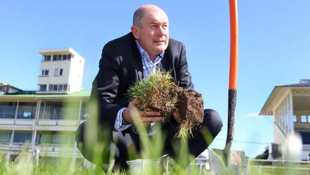 Southland Racing Club president Sean Bellew checking the root structure of grass on the galloping track at Ascot Park.