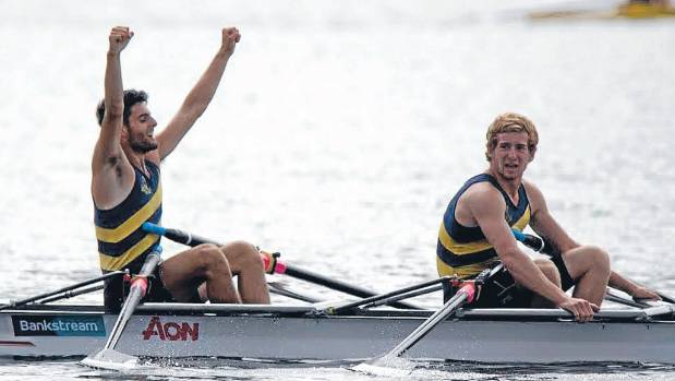 Gold medal-winners Jordon Gasson, arms raised, and Campbell Stevens savour the moment at the finish of the under-18 ...