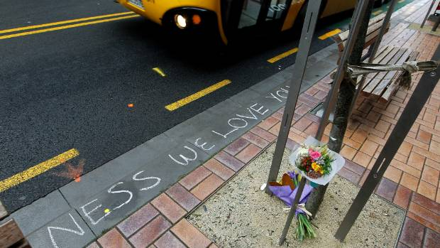Flowers at the spot on Wellington's Willis St where Venessa Green was hit by a bus in 2011.