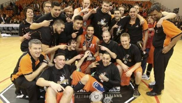 The 2013 Southland Sharks celebrate their maiden NBL title in Napier.