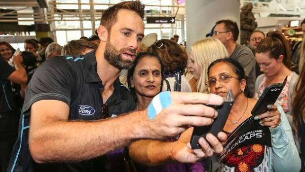 New Zealand's man of the World Cup Grant Elliott poses for photos with fans.