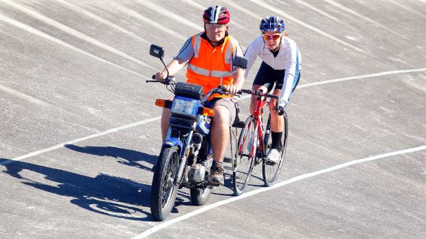 Cycling coach Gary Gibson sets the pace for Holly Blakely,15, at the Hataitai Velodrome, as she gears up for next week's ...
