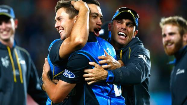 Ross Taylor, Trent Boult and Chris Donaldson hug with happiness.