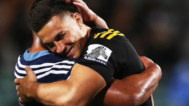 Hugging the on-field enemy - Charles Piutau of the Blues hugs Sonny Bill Williams of the Chiefs.
