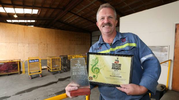 Local man Donald Simpson with the Devotion Award he was presented with last week from the Southland Entertainment Awards ...