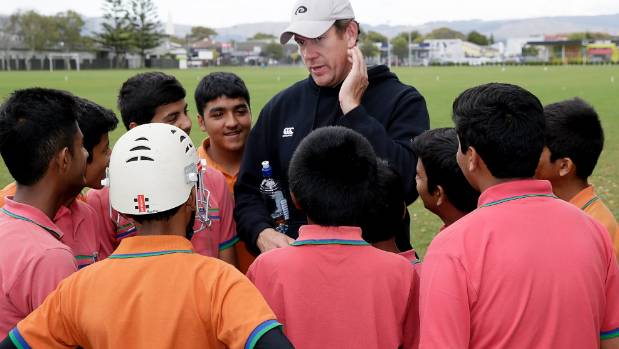Jacob Oram gives cricket pointers to keen young Indian players visiting Palmerston North.