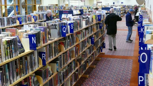 People wander through the Invercargill City Library.
