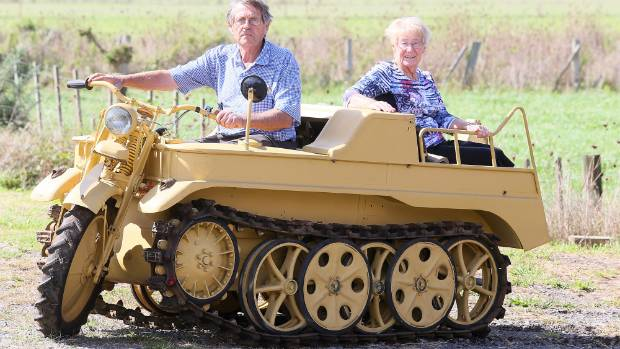 Ross, left, and Leonie Hopkins and their World War II German Kettenkrad motorcycle half-track.