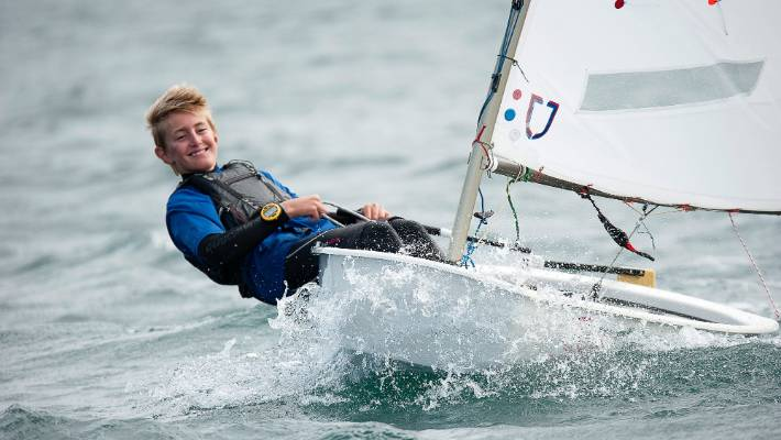 Scots College yachtsman Sam Bacon on his way to winning the national optimist title at Wellington.