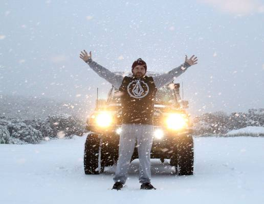 New Plymouth snowboarder Craig Balks checks out the early morning snowfall on Tuesday at Manganui Ski Area's plateau car ...