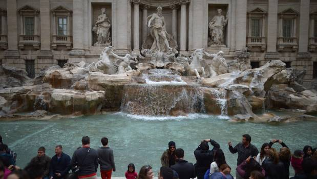 Tourists visit the Trevi Fountain in Rome.