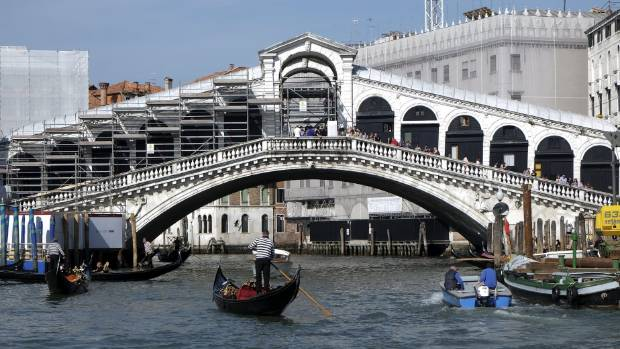 A man who jumped from the Rialto Bridge on the Grand Canal in Venice and crashed onto a passing water taxi is thought to ...