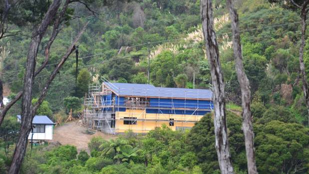 The build as seen from across the valley offers a bit of perspective on Michele's new home.