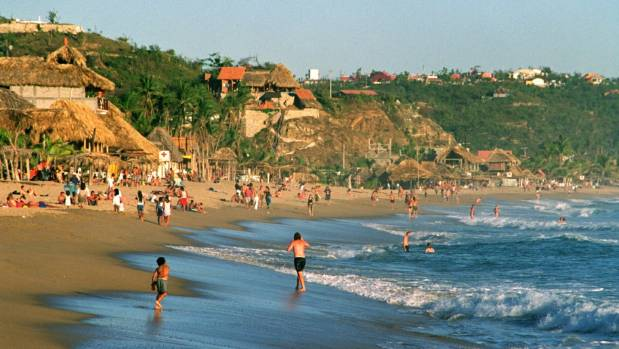 "Once touted as ""Mexico's last nude beach,"" Zipolite, along the southern coast of Oaxaca, now has more gawkers than those ..."