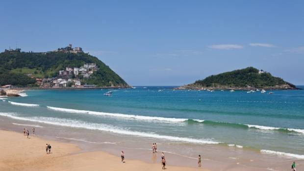 Playa de La Concha in San Sebastian, with Mount Igueldo and Isla Cristina in the background.