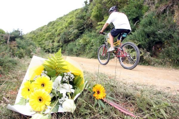 A floral tribute lies where Karl Kuchenbecker was killed in the Wainuiomata hills.