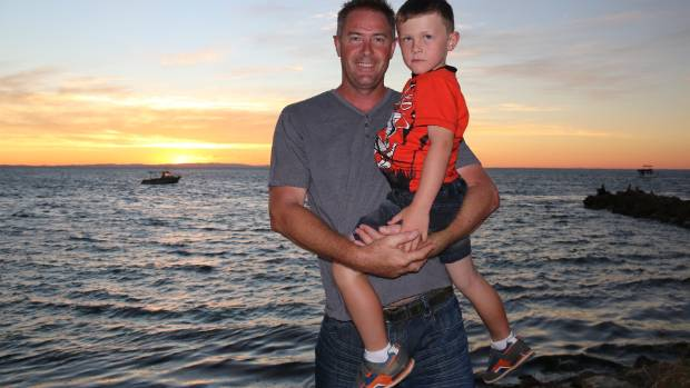 Geoff Hadfield with his son Jayme on a recent camping holiday at North Stradbroke Island in Queensland.