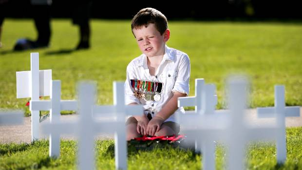 Omata School's youngest student Jai Meyer, 5, had the important job of laying a wreath at the school's Anzac service.