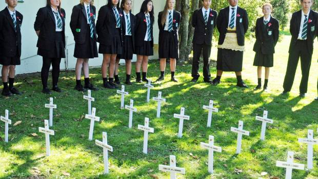 Taita College students put down crosses to remember the Fallen.