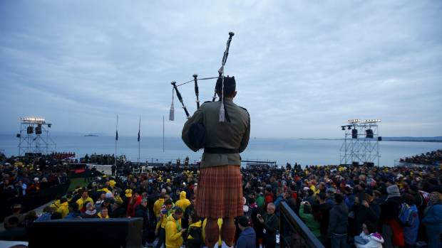 A bagpiper performs during a dawn ceremony at Anzac Cove.