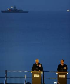 Britain's Prince Charles (L) speaks during the dawn ceremony at Anzac Cove