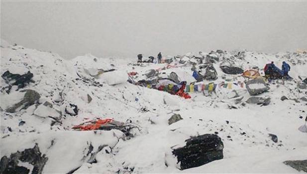 This photo provided by Azim Afif shows the scene after the avalanche swept across Everest Base Camp.