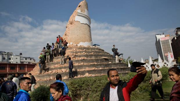 A man takes a selfie at the damaged historic Dharahara Tower, in Kathmandu. The earthquake gives Nepal the chance to ...
