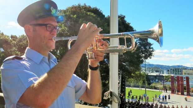 Royal New Zealand Air Force Band musician Lex French plays the Last Post at Pukeahu National War Memorial Park