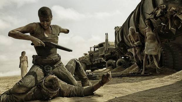 Charlize Theron muscles in as Furiosa.