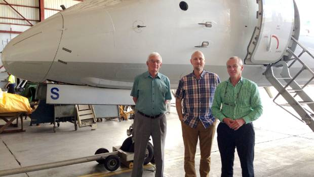 Kiwi Regional Airlines executives from left Peter Ashford, Ewan Wilson and Bill Wilson with a Saab 340 aircraft.