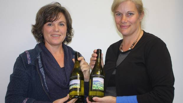 Waikato artist Jennie De Groot, left, and Mighty River Domain site manager Liz Stolwyk at the launch of the new wine labels.