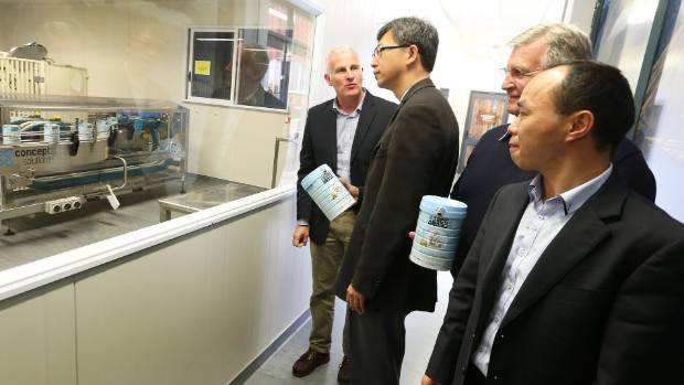 Blue River general manager Phil Neylon, Chinese Ambassador Wang Lutong, founder Keith Neylon, and Blue River ...