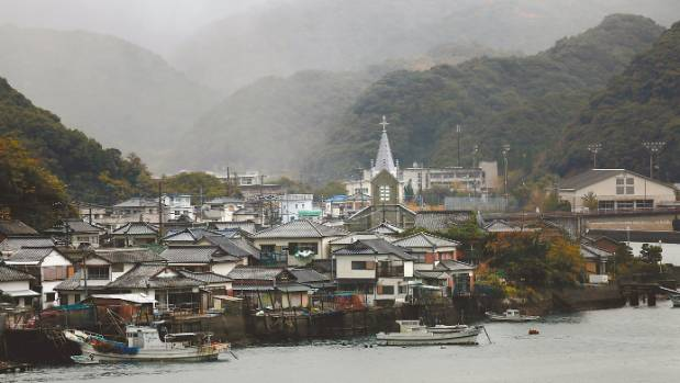 The Sakitsu Church and surrounding village is shrouded in rain in Amakusa, Japan.