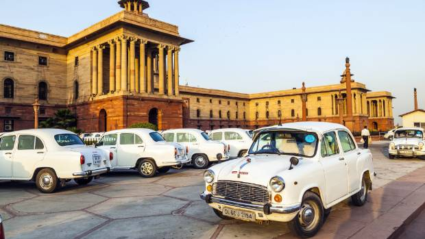 The Ambassador, the white boxy Indian car based on the 1958 Morris Oxford, proves a fine choice for a Rajasthan road trip.