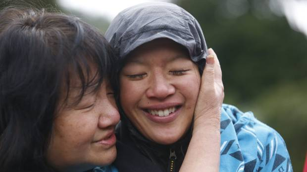 Susan O'Brien is hugged by her mother Maggie Khoo on being found.