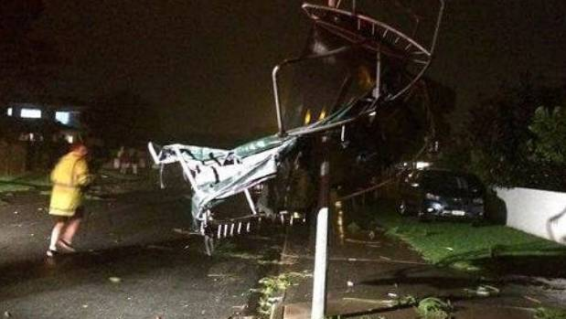 A trampoline was wrapped around a street light when a tornado whipped through Mt Maunganui.