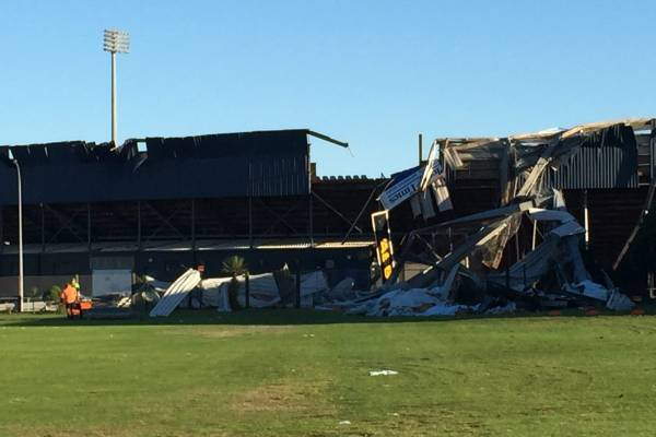 The storm had ripped the roofing off about three of Bay Park stadium's bays, flinging it across the field and out into ...