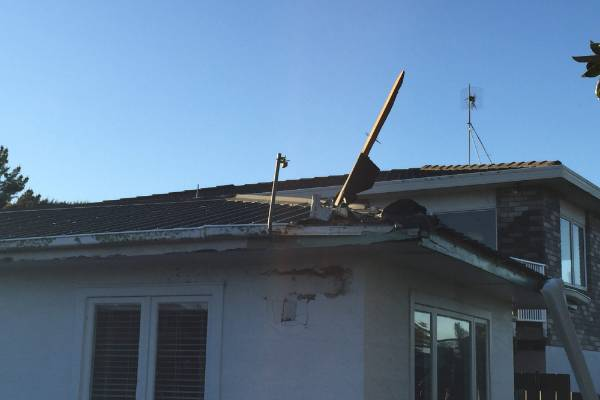 The tornado blew this piece of wood right through the roof of this house into a bedroom.