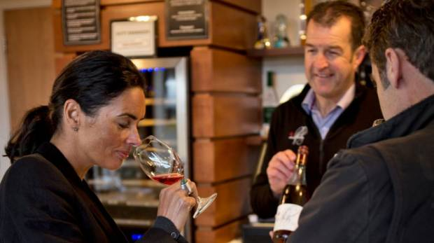 Mt Difficulty regional sales manager Greg Wilkinson holding a tasting in the cellar door. Photo: supplied
